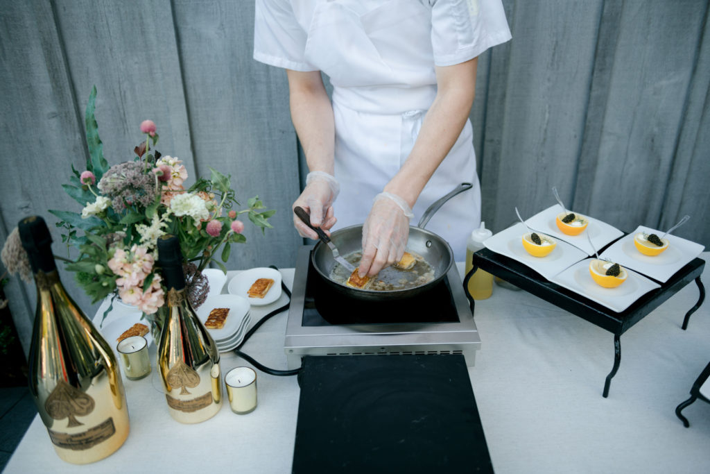 A CHEF'S TAKE ON A LUXURY SUMMER CHAMPAGNE ARMAND DE BRIGNAC CLAMBAKE IN THE HAMPTONS